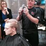 Randy Dingus Jr. demonstrates barbering techniques